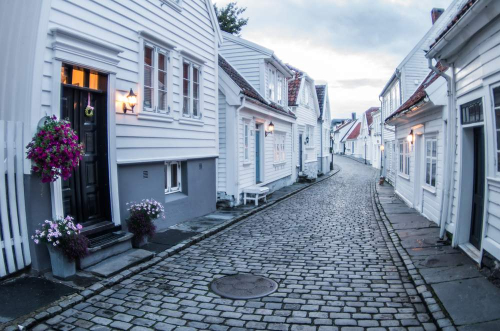 Filename c.+shutterstock_white+wooden+houses+Stavanger +Norway