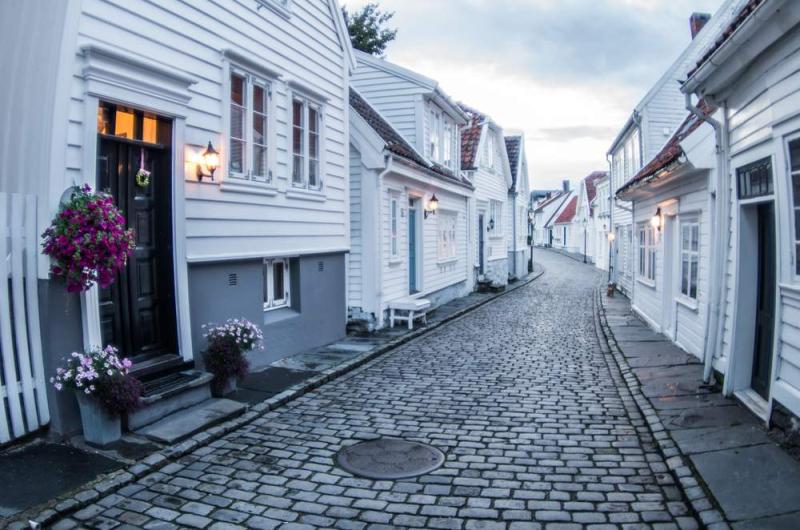 Filename c.+shutterstock_white+wooden+houses+Stavanger +Norway