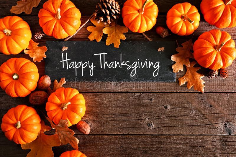 Happy-thanksgiving-chalkboard-sign-corner-border-pumpkins-leaves-over-rustic-wood-happy-thanksgiving-chalkboard-sign-159275824